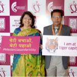 Dr Laxmi Shrikhande and Dr Anil Shrikhande posing with signs at Masterclass Infertility III